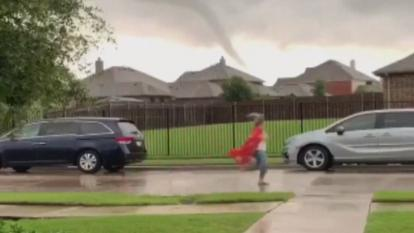 With her kimono blowing in the wind like a superhero's cape, Megan Parson, a fourth grade teacher at Hays Elementary in Rockwall, Texas, was photographed making her mad dash to the parents.