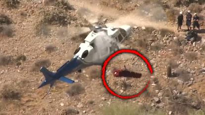 Helicopter spinning injured woman