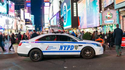 An NYPD squad car parked in Times Square.