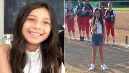 Marley McAninch, 9, performs the National Anthem at a California Little Leagues championship game.