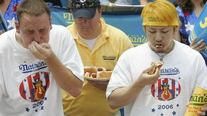 Joey Chestnut and Takeru Kobayashi chow down on hot dogs at the Nathan's Famous International Hot Dog Eating Contest in 2006.