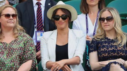 She was surrounded by security guards. The two women seen sitting with Meghan were her pals from Northwestern University.