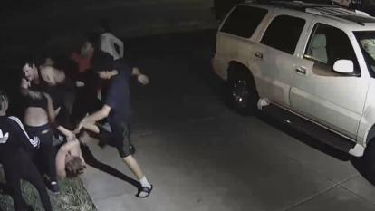 Disturbing video shows a woman being attacked by teens outside her home in California. When the woman's husband tried to step in, he was beaten as well.