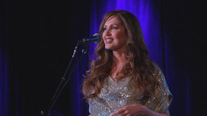 "Inside Edition's Lisa Guerrero performs her song, ""Everybody Loves a Comeback."""