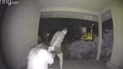 A terrifying video captured the moment a woman was dragged away from a front door by her hair as she pleaded for help.