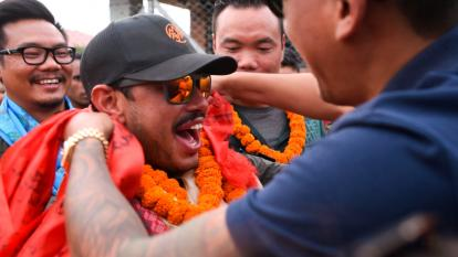 Nepali mountaineer Nirmal Purja reacts as he is garlanded after arriving in Tribhuvan airport in Nepal's capital Kathmandu on October 30, 2019.
