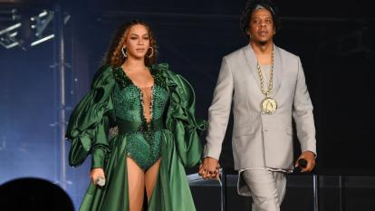 Beyonce and Jay-Z stand hand in hand