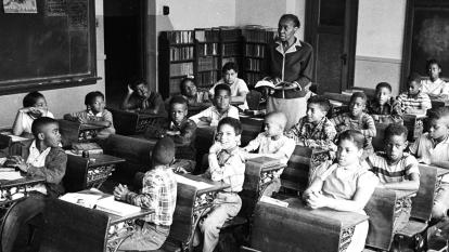 View of nine-year-old African-American student Linda Brown (bottom right) sits with her classmates at the racially segregated Monroe Elementary School, Topeka, Kansas, 1953. When her enrollment at a 'whites-only' school was blocked, her family initiated the landmark Civil Rights lawsuit 'Brown V. Board of Education,' that led to the beginning of integration in the US education system.