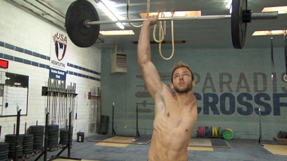 one armed weightlifter inside edition