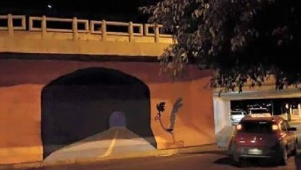 Street Artist Painted A Road Runner Tunnel On A Wall