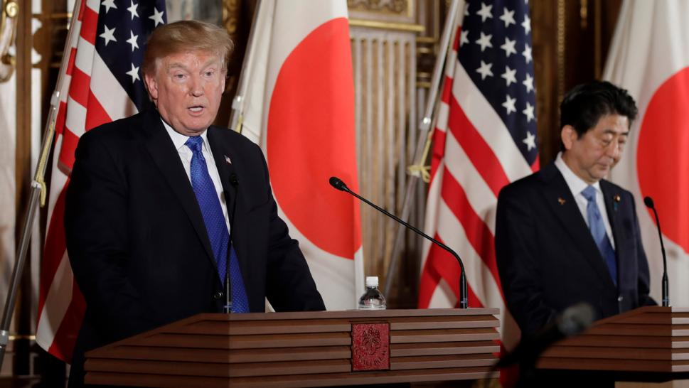 President Donald Trump speaks as Japanese Prime Minister Shinzo Abe looks on during a news conference in Tokyo, Japan, on Monday.