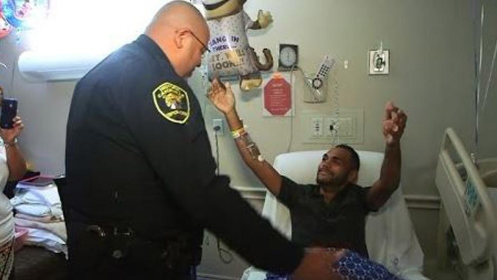 Officer Omar Delgado visiting Orlando terror victim Angel Colon.