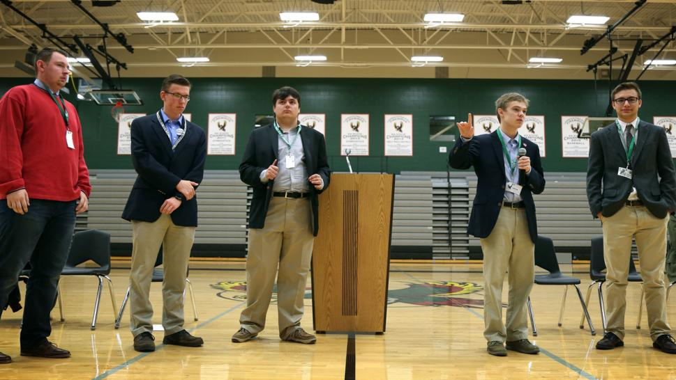 Tyler Ruzich (2nd R), 17, flanked by Ethan Randleas (L), 17, Jack Bergeson (3rd L), 16, of Wichita, and his running mate Lt. Governor Candidate Alexander Cline (2nd L) and Dominic Scavuzzo, 17, speaks during a forum in Lawrence.