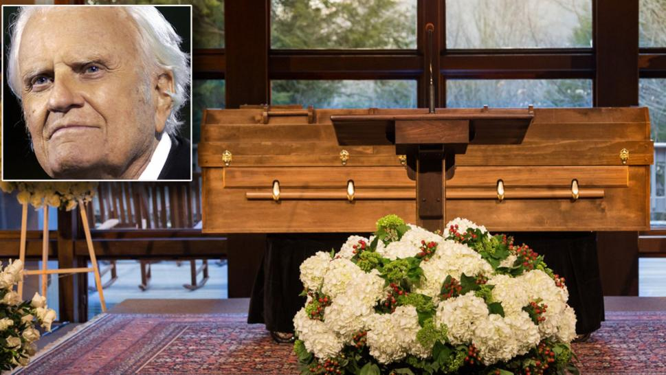 The body of Billy Graham rests behind a pulpit at The Billy Graham Training Center at The Cove in Asheville, N.C. in a simple pine casket made by prison inmates