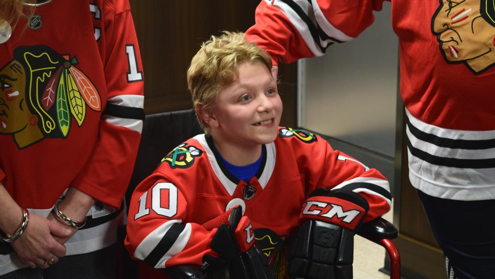 Mason Berg, 12, prepares to play some ice hockey with the Chicago Blackhawks.