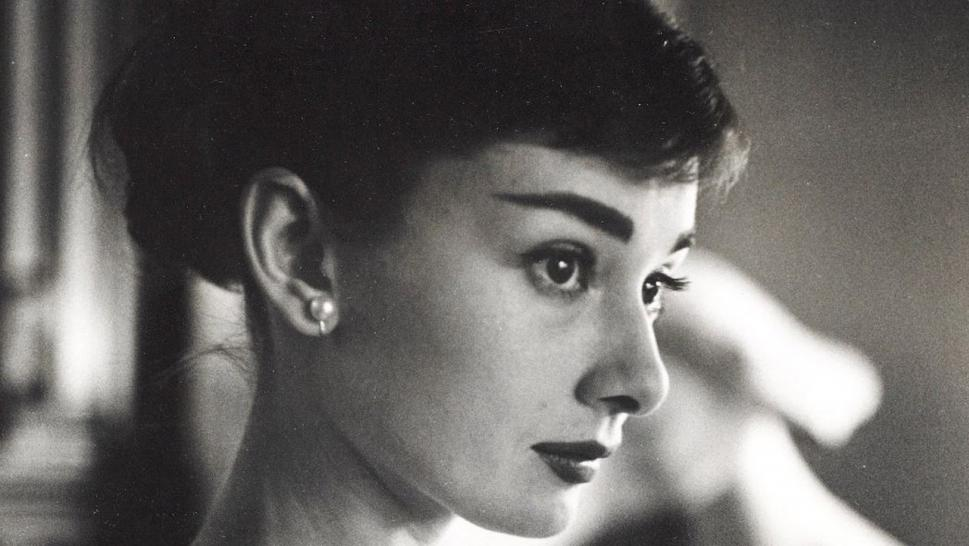 Audrey Hepburn's iconic pearl earrings are going to be auctioned.