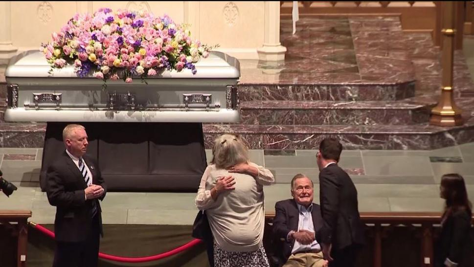 Barbara Bush's body lies in repose as her husband greets mourners.