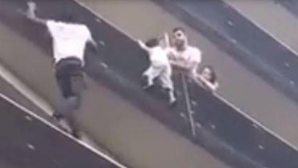 Real life 'spider-man' saves boy dangling from Paris balcony