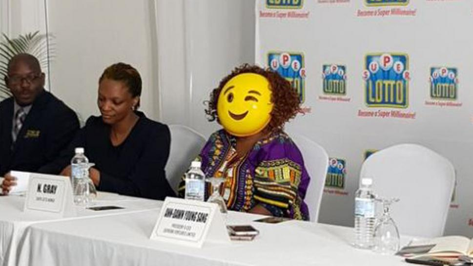 The lottery winner identified only as N. Gray wore an emoji mask to protect her identity