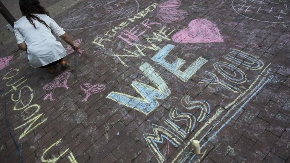 Chalk drawings in memory of a murder victim.