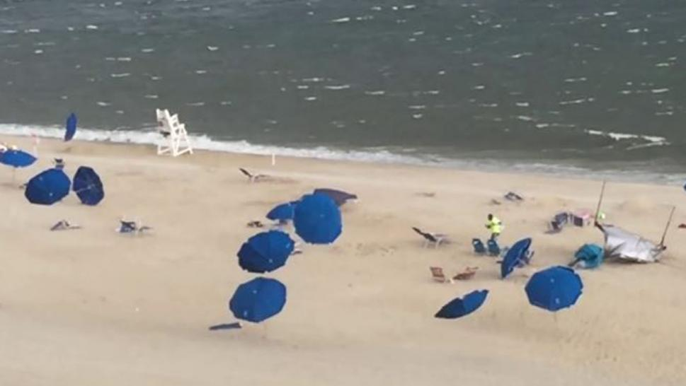 A woman was struck in the chest by a beach umbrella in Maryland.
