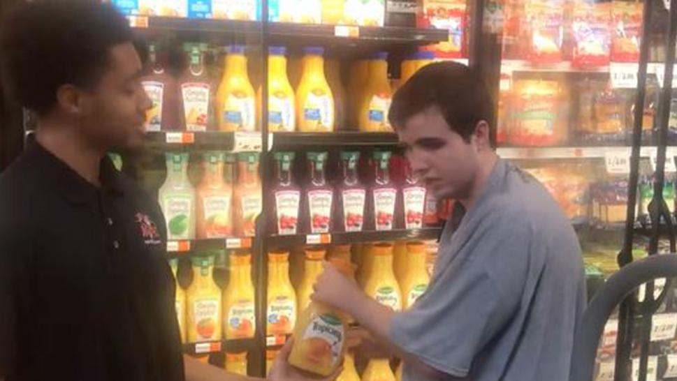 Grocery store employee lets teen with autism help him do his job.
