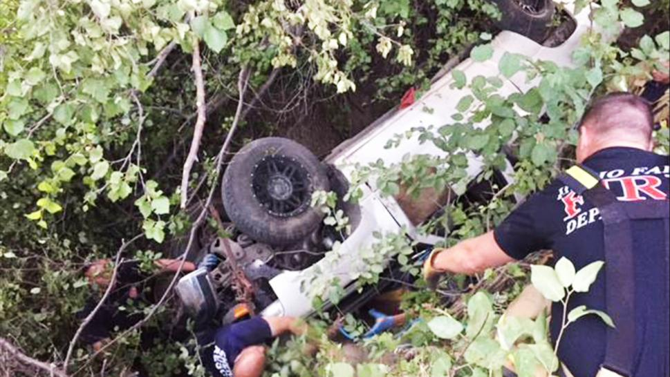 Authorities found the missing man pinned under an overturned truck.