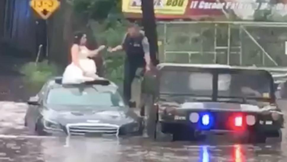 Bride rescued from flood