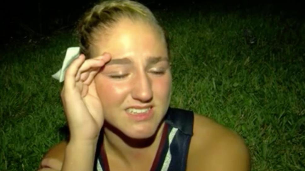 Cheerleader cries after shooting