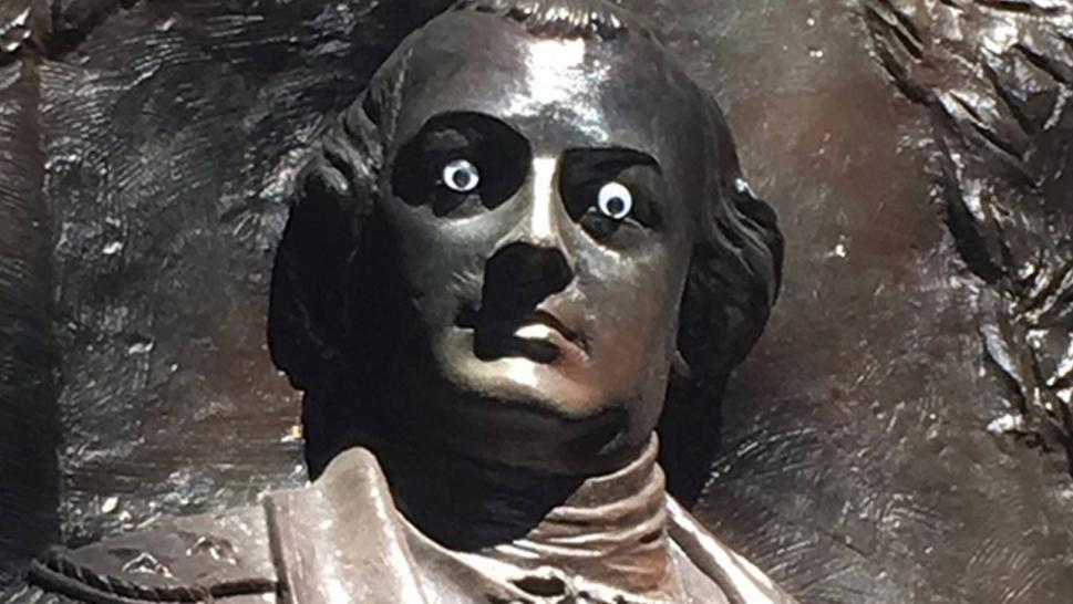 Googly-eyed statue