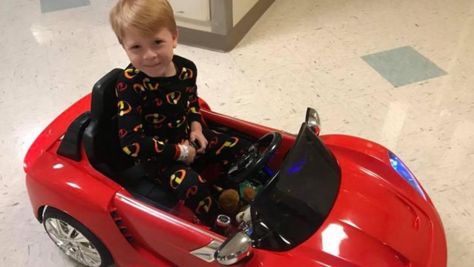 A 6-year-old boy rides in style to his brain surgery.