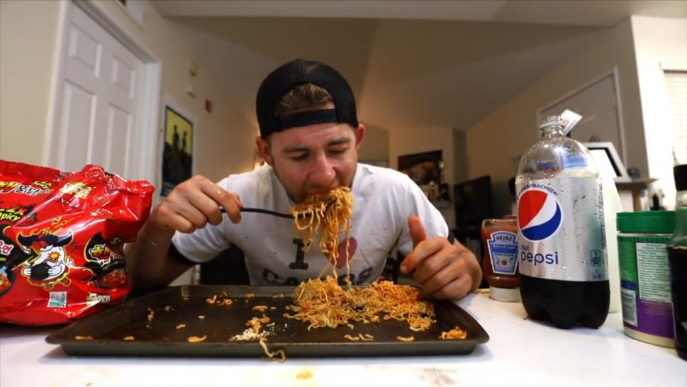 Man taking on the fire noodle challenge