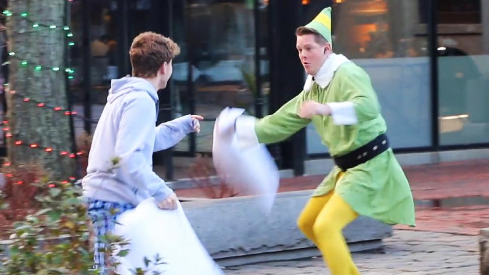 Man dressed as an elf in a pillow fight