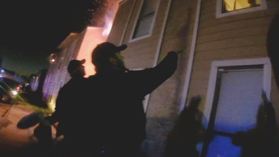 A Texas boy jumped out of a burning building and into police officers arms.