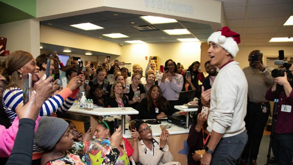 Barack Obama visited a children's hospital to spread Christmas cheer.