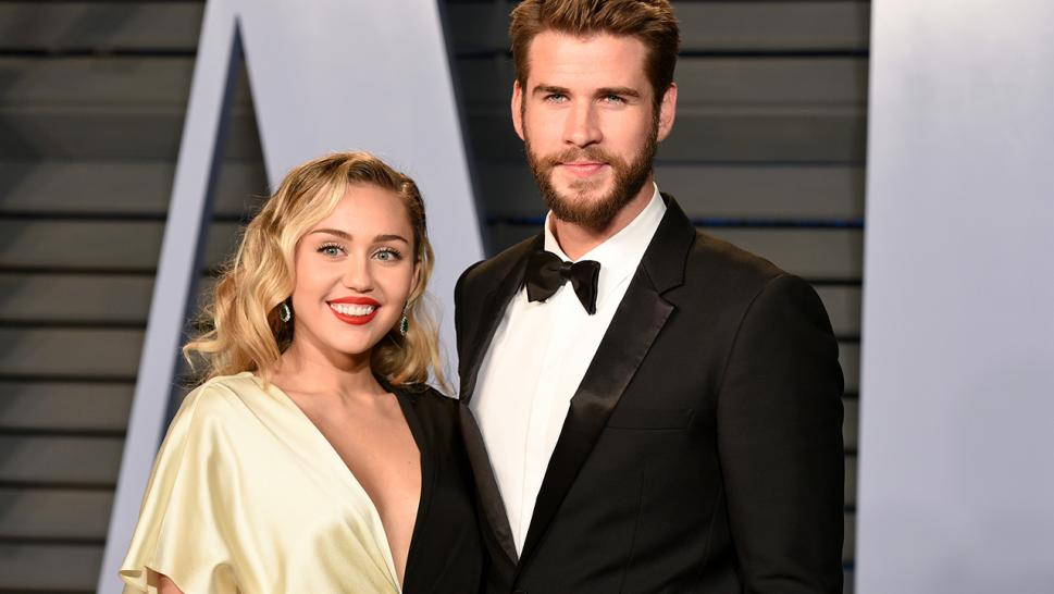 Miley Cyrus and Liam Hemsworth pose together earlier this year.