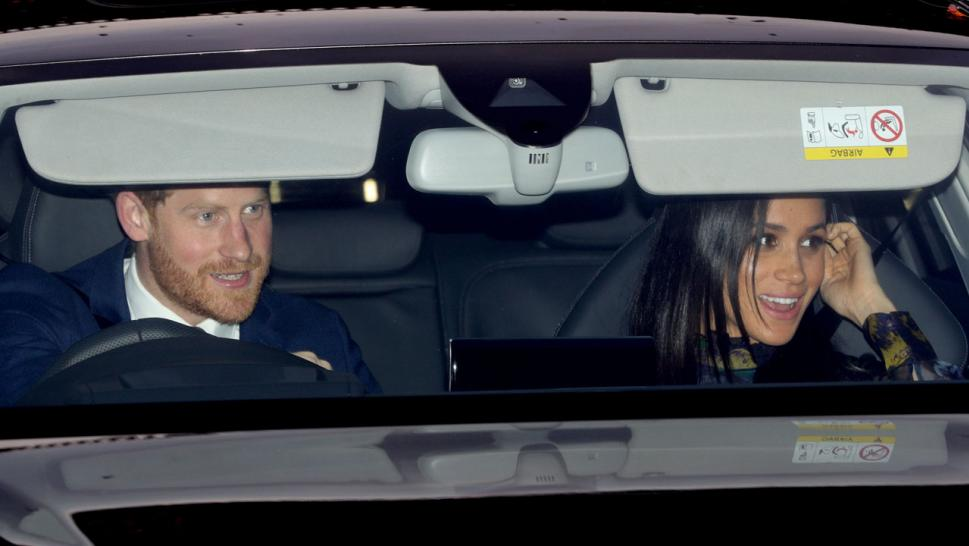Meghan Markle and Prince Harry leave the queen's Christmas lunch at Buckingham Palace.