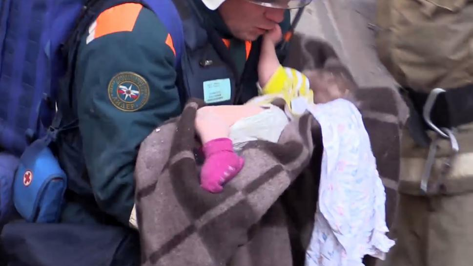A baby boy was pulled from the rubble of a collapsed apartment building in Russia 35 hours after the structure fell.