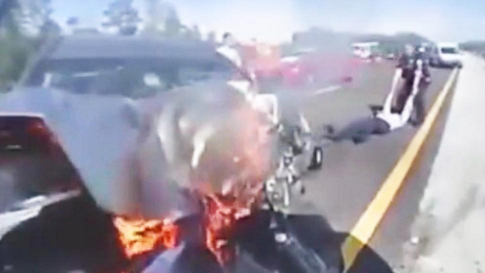 A Florida Highway Patrol officer saved driver from fiery crash.