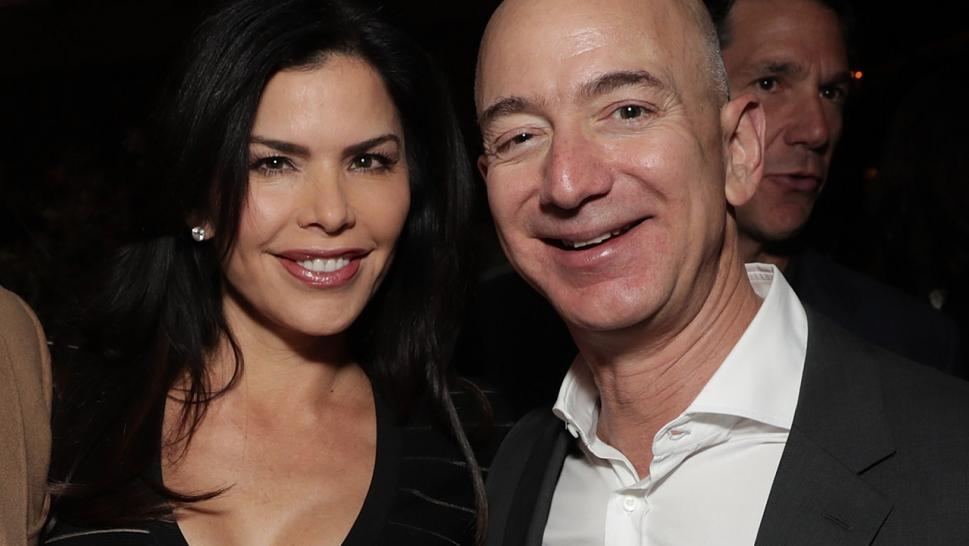 Jeff Bezos and his girlfriend Lauren Sanchez pose together at Amazon's Golden Globes party.