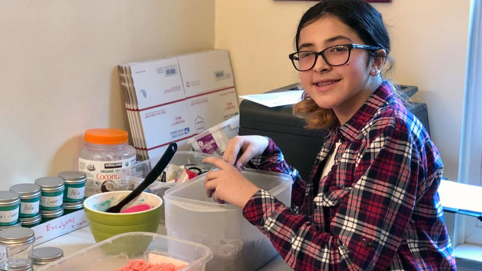 11-year-old Bella makes sugar scrubs for her new business.