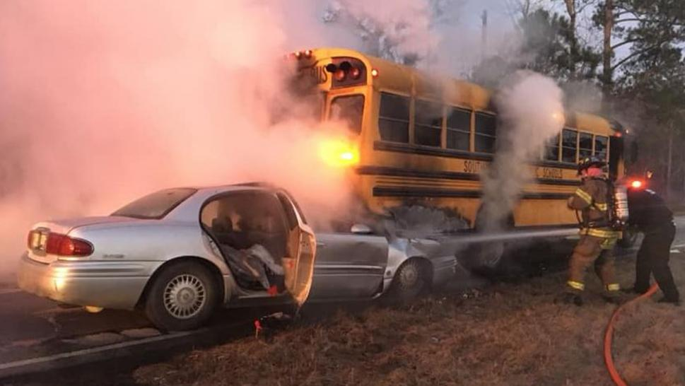 A school driver is being praised for rescuing 40 kids from burning bus.