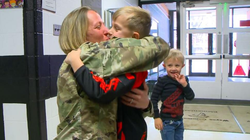 Master Sgt. Amy Carpenter with her sons, Dane and Knox.