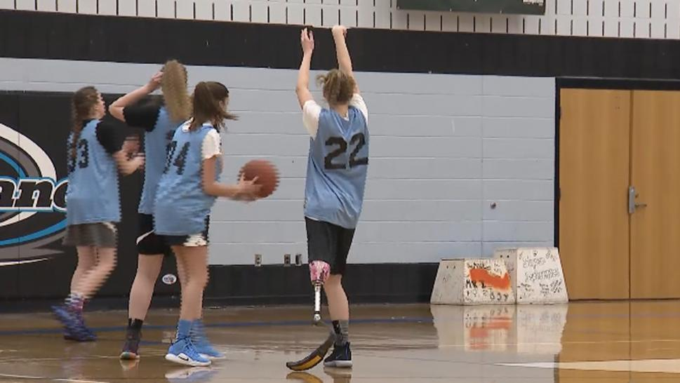 A teen amputee is a varsity basketball player at a Maryland high school.