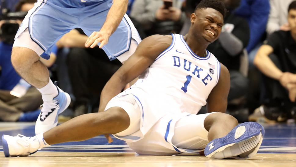 The shoe ripped violently, exposing his entire foot and causing the freshman sensation to bow out of the game with a sprained knee in Durham, North Carolina.