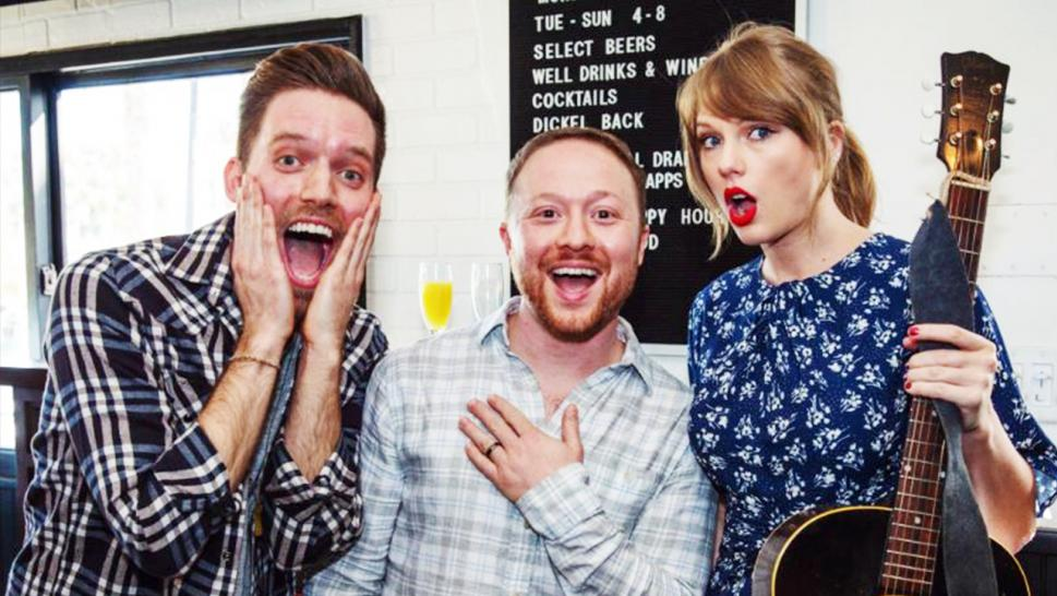 Taylor Swift poses for a photo with the newly-engaged couple.