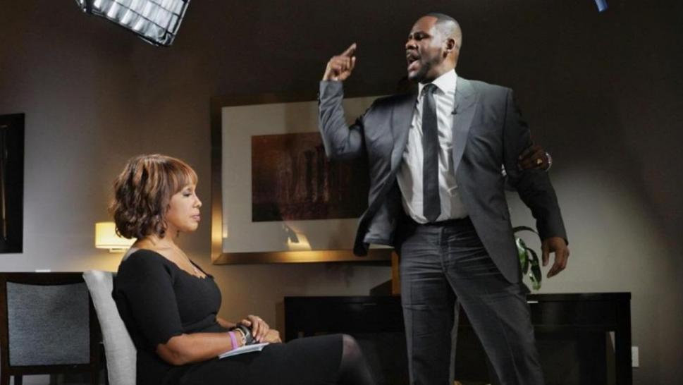 R. Kelly points a finger during his interview with Gayle King.