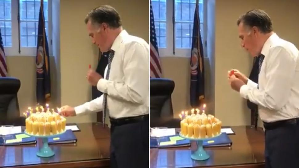 Mitt Romney blows out his birthday candles one by one.