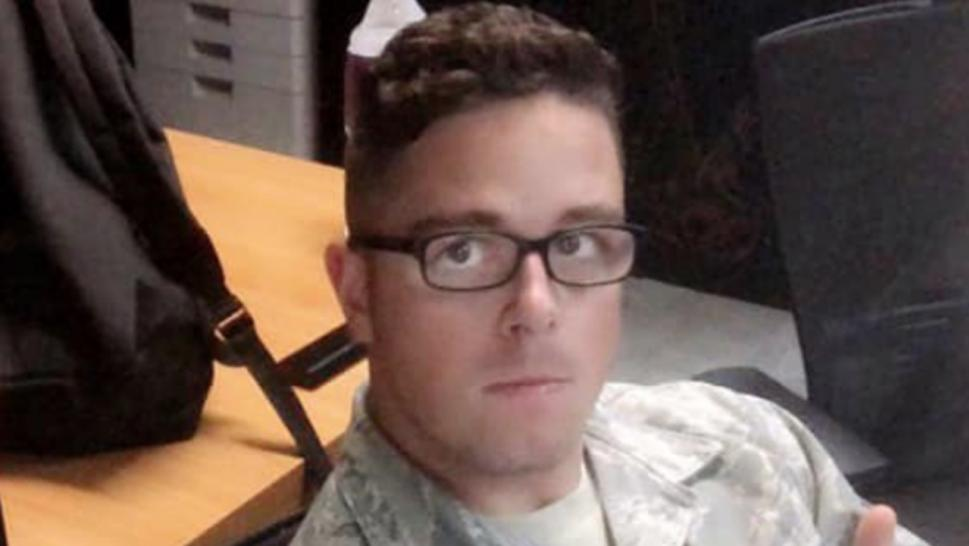 The airman was killed while trying to stop an armed robbery.
