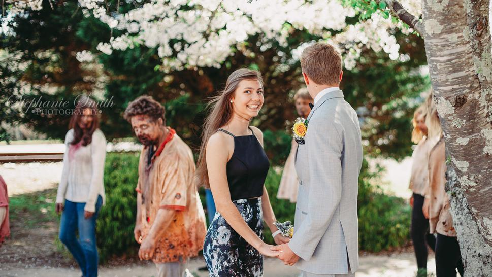 Zombies photobombed a Georgia couple posing for prom pictures.